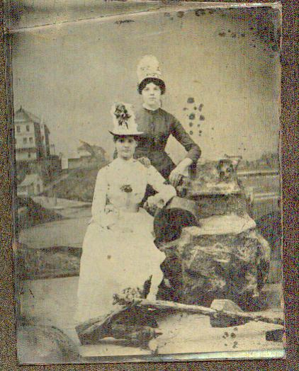 Bessie and sister Clara ... hopefully having fun at a fair (those hats can't be for real!)