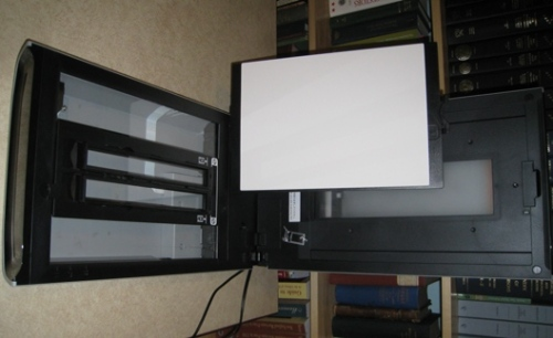 """Canoscan with guide in place, and white padded """"protective sheet"""" removed from top cover."""