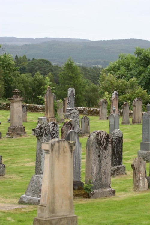 "Old Kilmorack Cemetery with ""a view of the hills of the Parish of Kiltarlity - probably Beauly - but looking up towards Teagate."" Photo by Alex MacLeod. Used with permission."