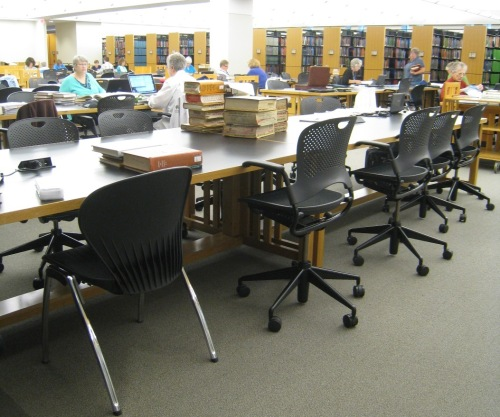 Large work tables near the books