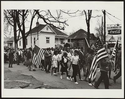 Participants, some carrying American flags, marching in the civil rights march from Selma to Montgomery, Alabama in 1965. Photo by Peter Pettus.  Library of Congress LC-USZ62-133090