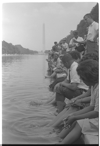 Demonstrators sit, with their feet in the Reflecting Pool, during the March on Washington, 1963. Photo by Warren K Leffler. From Library of Congress, LC-DIG-ds-00834.