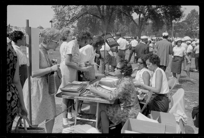 Souvenir booklet sales table at the March on Washington, 1963.  Photo by Marion S. Trikisko. Library of Congress LC-DIG-ppmsca-37235