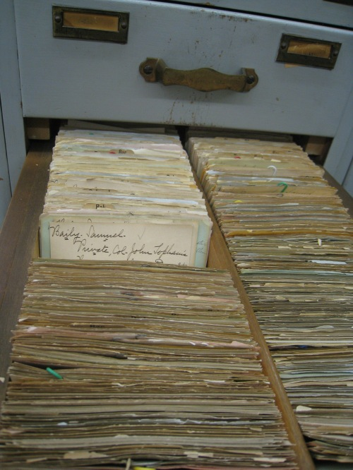 Each drawer is filled with alphabetized slips of references to R.I. Rev. War military personnel