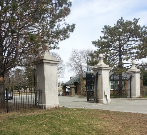 The southern entrance shows the cemetery office just inside the gates.