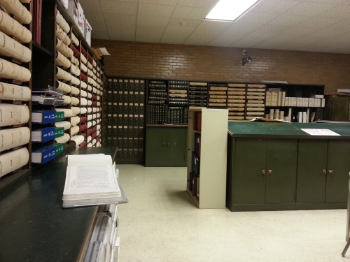 The room with the old records.  To one side, there are some tables and chairs.