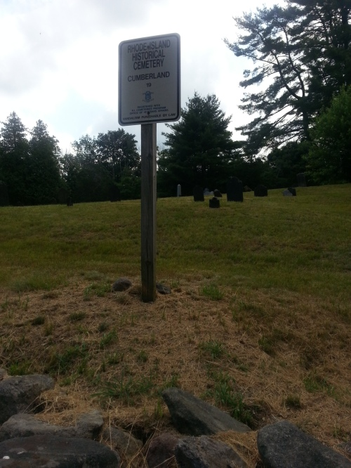 The Rhode Island Historic Cemetery marker.  This one is from Peck Cemetery, Cumberland.  Photo by Diane Boumenot.