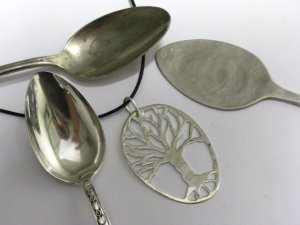 A pendant made from an antique silver spoon, by Barb's Branches.