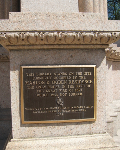 Plaque on a front pillar: This Library stands on the site formerly occuped by the Mahlon D. Ogden Residence, the only house in the path of the great fire of 1871 which was not burned.