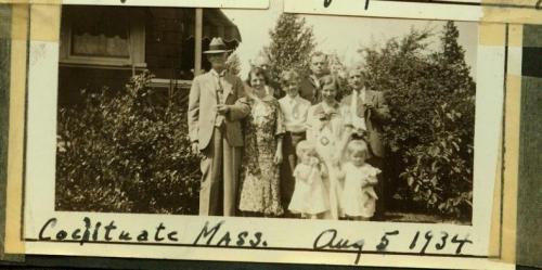 Uncle Gene in suit and hat, when he still lived in Cochituate, Mass., with other relatives including mom and her twin sister, two adorable toddlers.