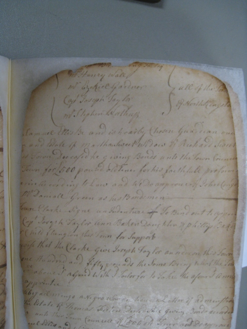 A North Kingstown probate records.  Due to damage from an explosion, the records are challenging to use, although a great deal of effort has been put into restoration.