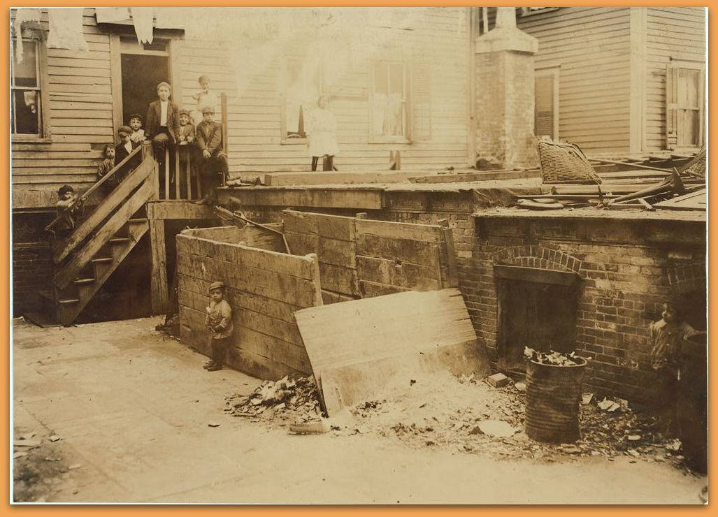 Entrance to the crowded, dirty house of a Midwife, rear tenement on Spruce Street, Providence, R.I. Location: Providence, Rhode Island. LC-DIG-nclc-04793 (color digital file from b&w original print)