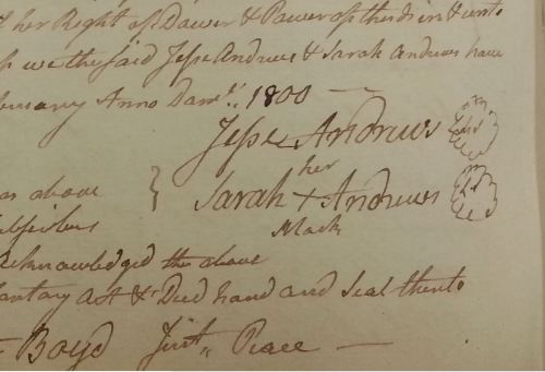 Signature of Jesse and Sarah Andrews on the deed. He signed, she made her mark.