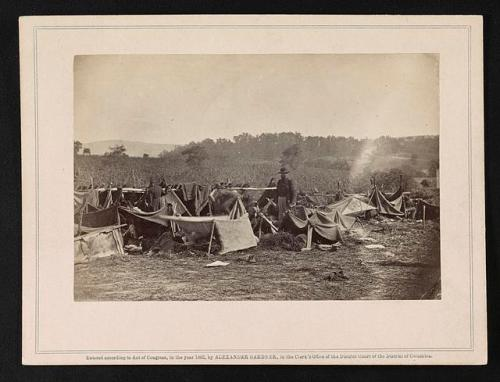 Attending the Confederate wounded after the Battle of Antietam. Dr. A. Hurd, 14th Indiana Volunteers. Confederate soldiers under tents at Smith's barn near Keeedysville, Md. Photo by Alexander Gardner. Library of Congress Prints & Photographs Online Catalog LC-DIG-ds-05198.