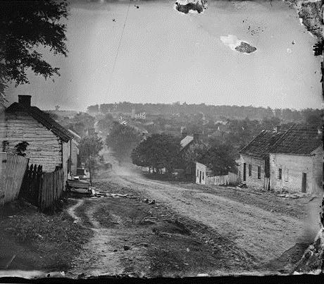 Half of a glass steroegraph of the principal street of Sharpsburg, Maryladn where the Battle of Antietam was fought. Photograph by Alexander Gardner, Sept., 1862. Library of Congress Prints & Photographs ONline Catalog, LC-B815-595 .